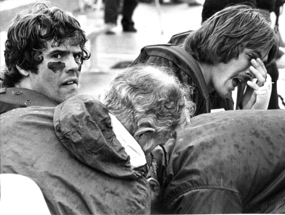 "Photo - OU FOOTBALL Steve Davis;   ""It's a worried Steve Davis being examined on the bench after suffering a charley horse"" during the Sooners' 62-7 season and home-opening win over Oregon.  Staff photo by Al McLaughlin taken 9/13/75; photo ran in the 9/15/75 Oklahoma City Times.  File:  Football/OU/OU-Oregon/Steve Davis/1975"