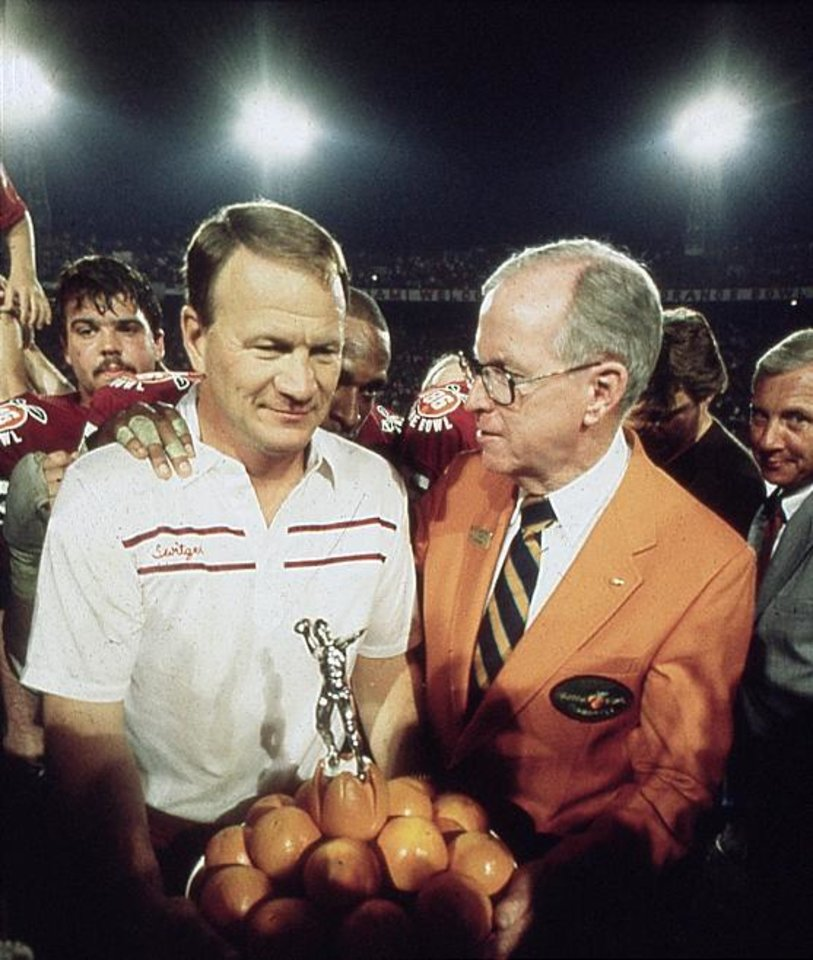 Photo - OU head college football coach Barry Switzer with the 1986 Orange Bowl trophy in Miami, FL. on 1-1-86. Staff photo.
