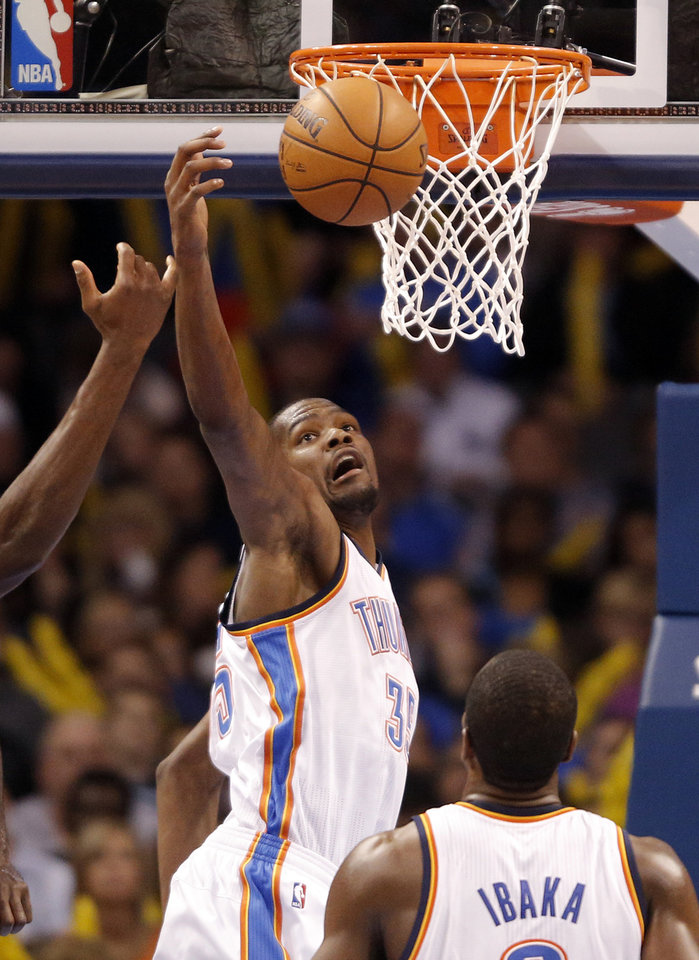 Oklahoma City 's Kevin Durant (35) fights for the ball during an NBA basketball game between the Oklahoma City Thunder and the Golden State Warriors at Chesapeake Energy Arena in Oklahoma City, Sunday, Nov. 18, 2012.  Photo by Garett Fisbeck, The Oklahoman