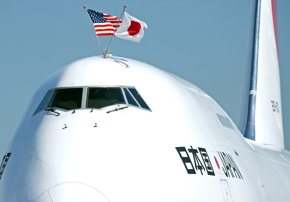 Photo -   The plane carrying Japanese Prime Minister Yoshihiko Noda flies American and Japanese flags during arrival at Andrews Air Force Base, Md., Sunday, April 29, 2012. President Barack Obama will meet with Noda at the White House, Monday, April 30, 2012. (AP Photo/Cliff Owen)