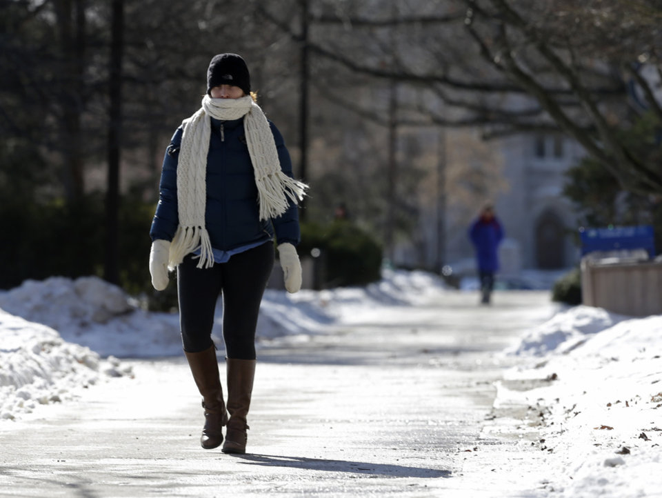 Photo - A student on the campus of Butler University walks to her class Monday, Jan. 27, 2014, in Indianapolis. Below-zero high temperatures have returned to many parts of the Midwest bringing with it wind chills ranging from the negative teens to 40-below. (AP Photo/Darron Cummings)
