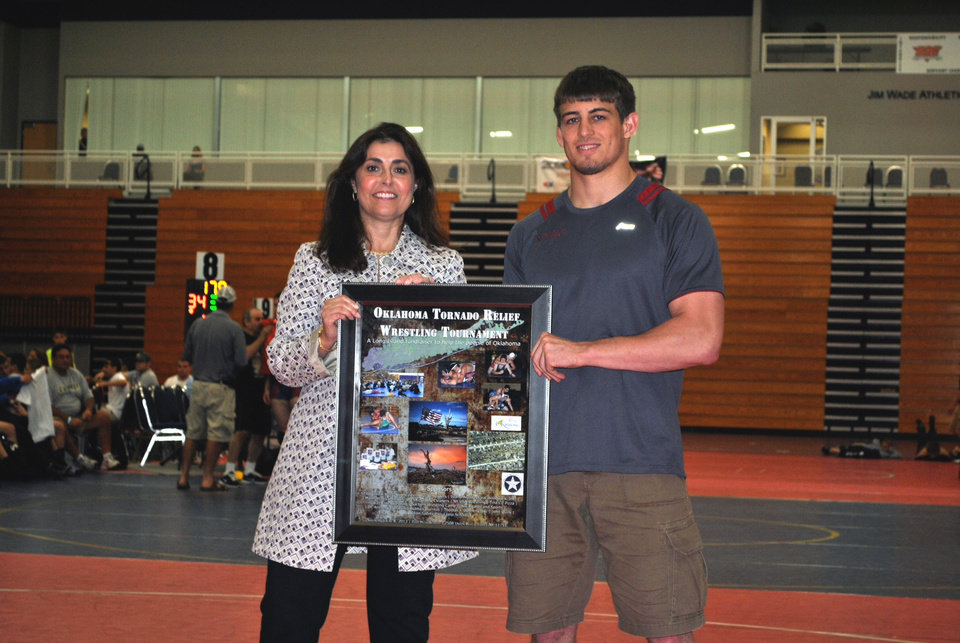 Team New York coach Dave Foxen, Jr., gave United Way of Central Oklahoma President and CEO Debby Hampton a check for $7,200 to go to the May Tornadoes Relief Fund at Junior National Duals on June 27 at Oklahoma City University. Read more at ocusports.com.