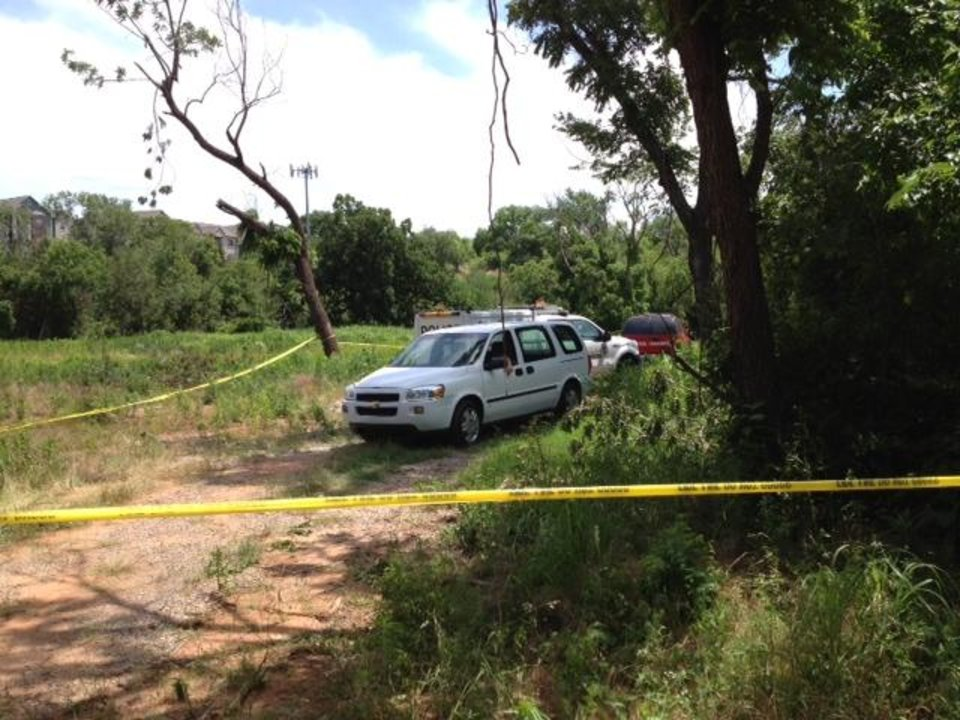 Witnesses here say the body was found by search team comprised of family and friends. Photo by Jim Beckel