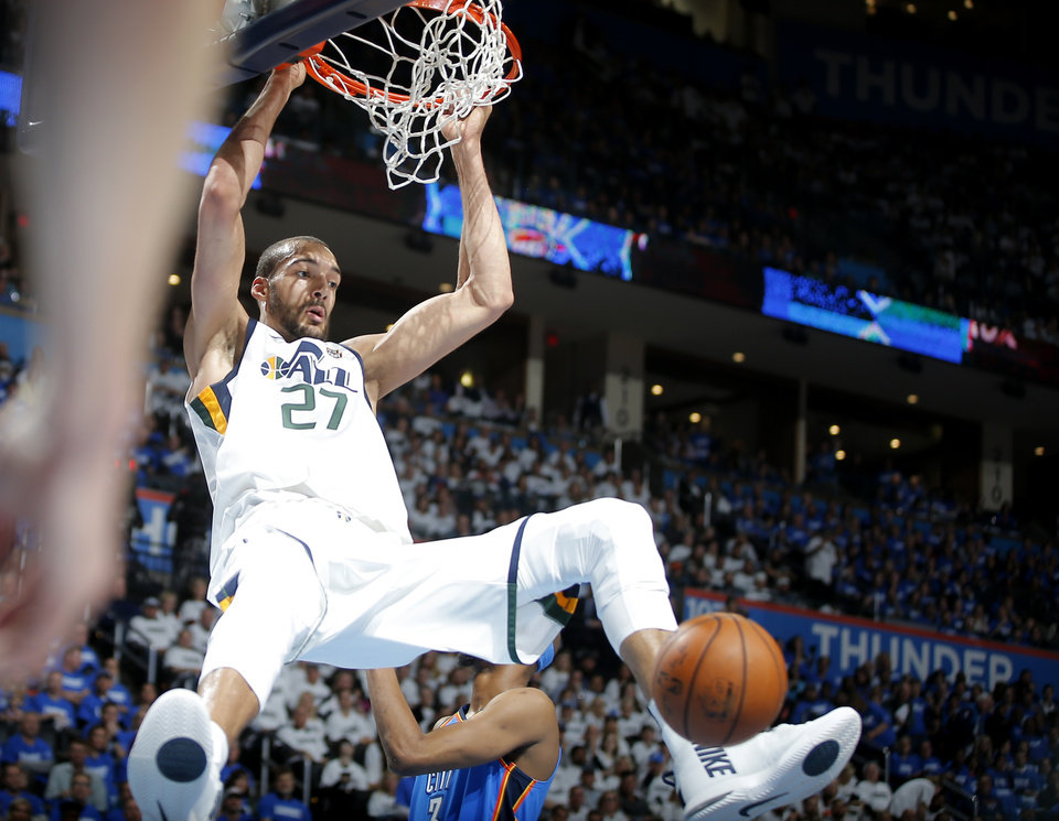 Photo - Utah's Rudy Gobert (27) dunks during Game 5 of the first round NBA playoff series between the Oklahoma City Thunder and the Utah Jazz at Chesapeake Energy Arena in Oklahoma City, Wednesday, April 25, 2018. Utah won 102-95. Photo by Bryan Terry, The Oklahoman