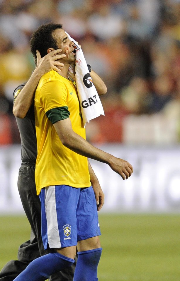 Photo -   Brazil's Sandro comes off the field after an injury during the first half of an international friendly soccer game against the United States, Wednesday, May 30, 2012, in Landover, Md. (AP Photo/Nick Wass)