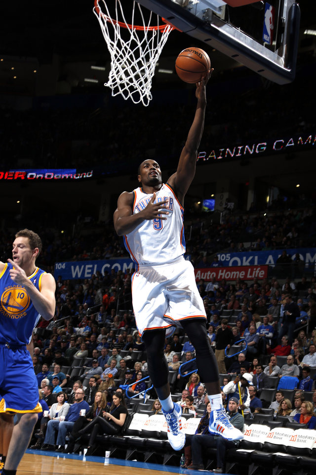 Oklahoma City\'s Serge Ibaka (9) goes up for a lay up during the NBA game between the Oklahoma City Thunder and the Golden State Warriors at the Chesapeake Energy Arena, Friday, Nov. 29, 2013. Photo by Sarah Phipps, The Oklahoman