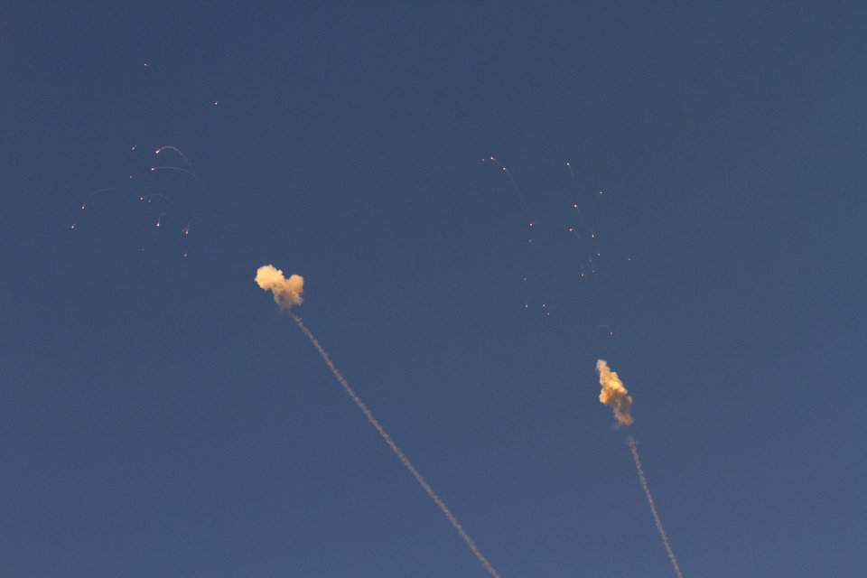 Two Iron dome rockets explodes to intercept rockets launched from the Gaza Strip by Palestinians militants, seen from the Israel Gaza Border, southern Israel,Thursday, Nov. 15, 2012. (AP Photo/Ariel Schalit)