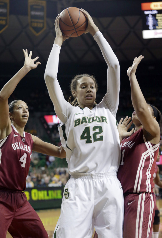 Baylor\'s Brittney Griner (42) controls the ball against Oklahoma\'s Nicole Griffin (4) and Nicole Kornet (1) during the second half of an NCAA college basketball game Saturday, Jan. 26, 2013, in Waco Texas. Baylor won 82-65. (AP Photo/LM Otero) ORG XMIT: TXMO117