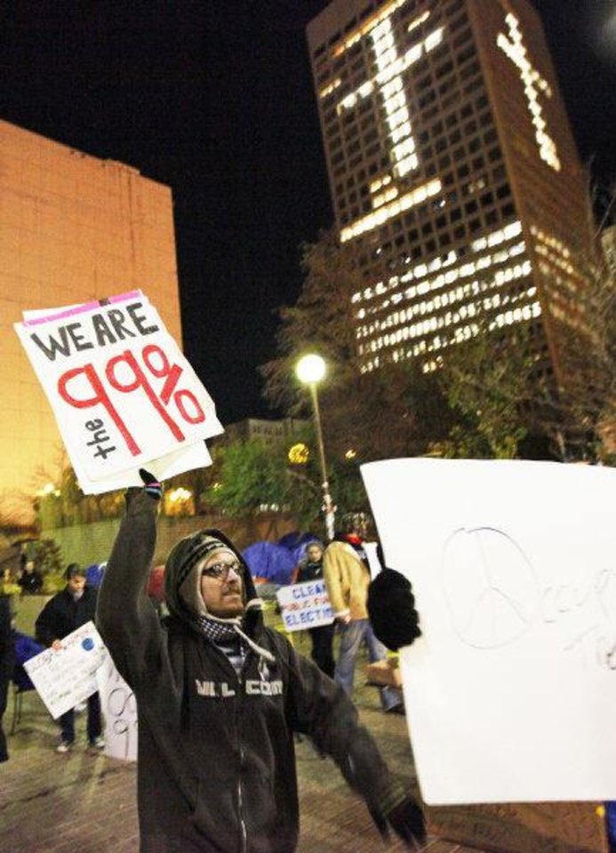 Photo - Right: Protesters march late Monday at Kerr Park in downtown Oklahoma City. PHOTO by Nate Billings, The Oklahoman