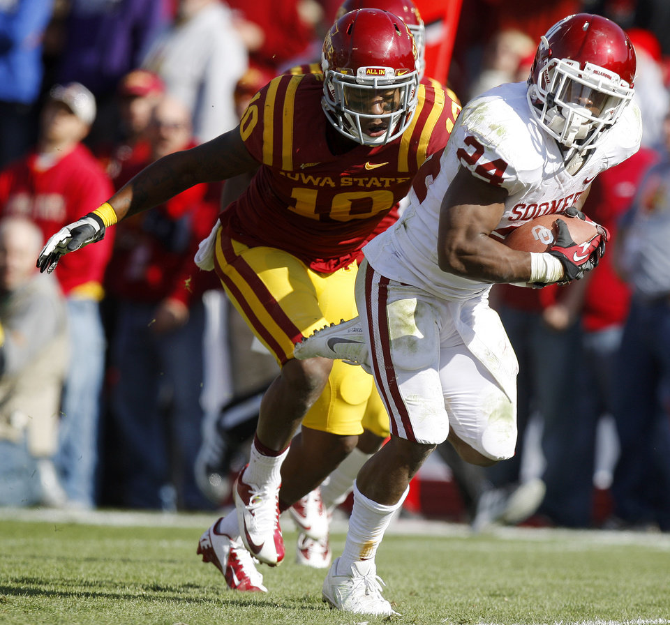Photo - Oklahoma's Brennan Clay (24) runs past Iowa State's Jacques Washington (10) for a touchdown during a college football game between the University of Oklahoma (OU) and Iowa State University (ISU) at Jack Trice Stadium in Ames, Iowa, Saturday, Nov. 3, 2012. Oklahoma won 35-20. Photo by Bryan Terry, The Oklahoman
