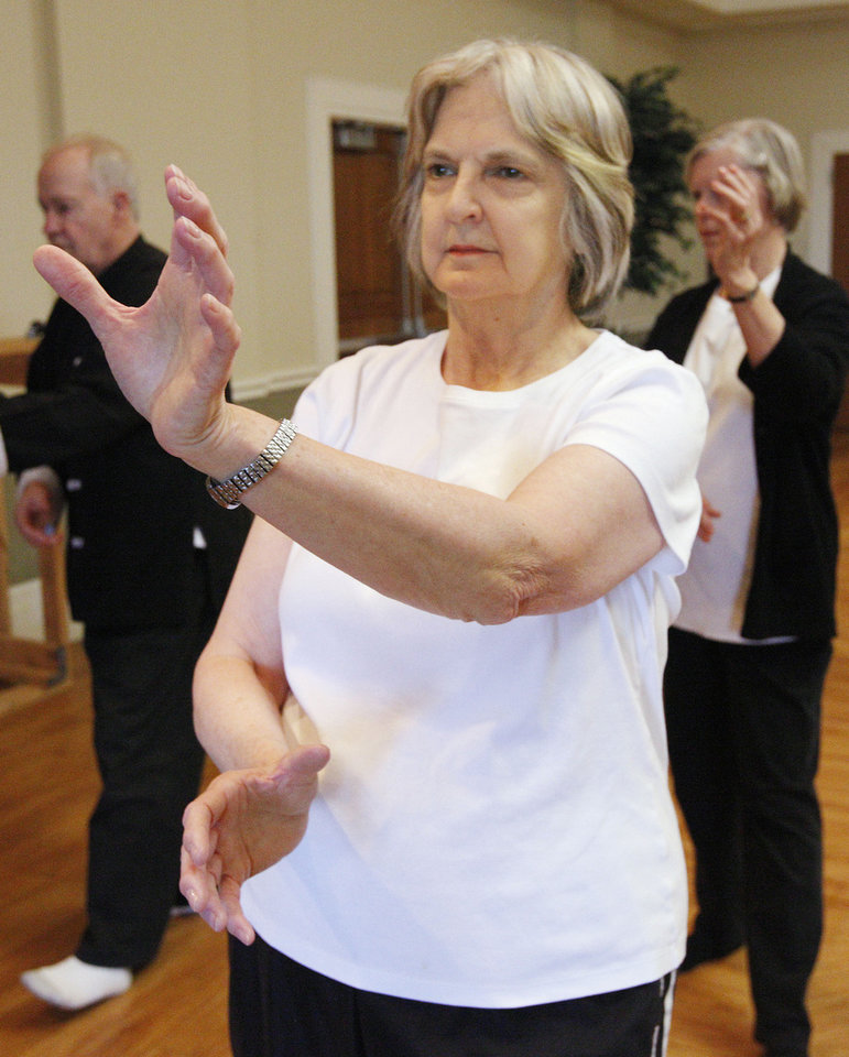 Photo - Right: Sue Hite, of Edmond, participates in a tai chi class at the Edmond Senior Center.