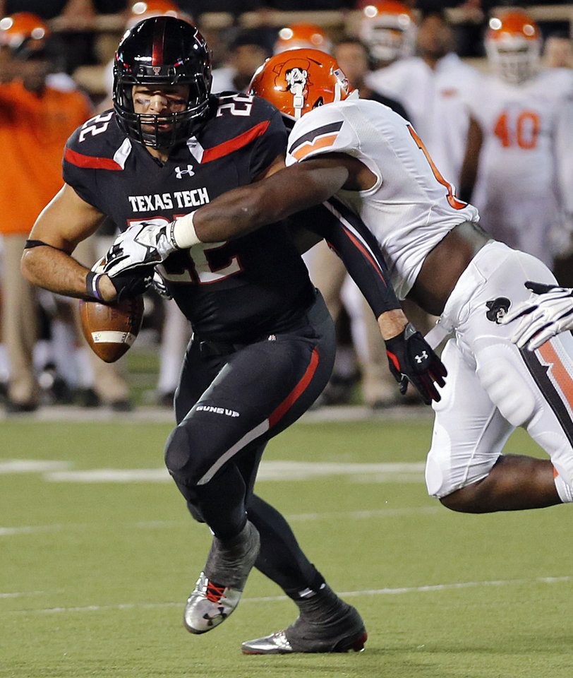 Oklahoma State 's Shaun Lewis (11) puts a hit on Texas Tech's Jace Amaro (22) during the college football game between the Oklahoma State University Cowboys (OSU) and the Texas Tech University Red Raiders (TTU) at Jones AT&T Stadium in Lubbock, Tex. on Saturday, Nov. 2, 2013.  Photo by Chris Landsberger, The Oklahoman