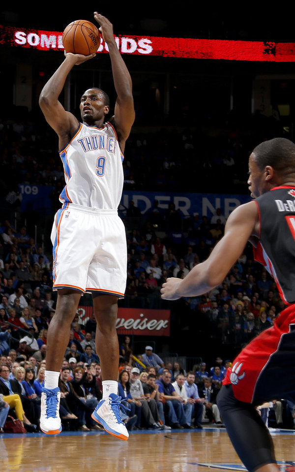 Oklahoma City\'s Serge Ibaka (9) shoots the ball during an NBA basketball game between the Oklahoma City Thunder and the Toronto Raptors at Chesapeake Energy Arena in Oklahoma City, Tuesday, Nov. 6, 2012. Tuesday, Nov. 6, 2012. Oklahoma City won 108-88. Photo by Bryan Terry, The Oklahoman