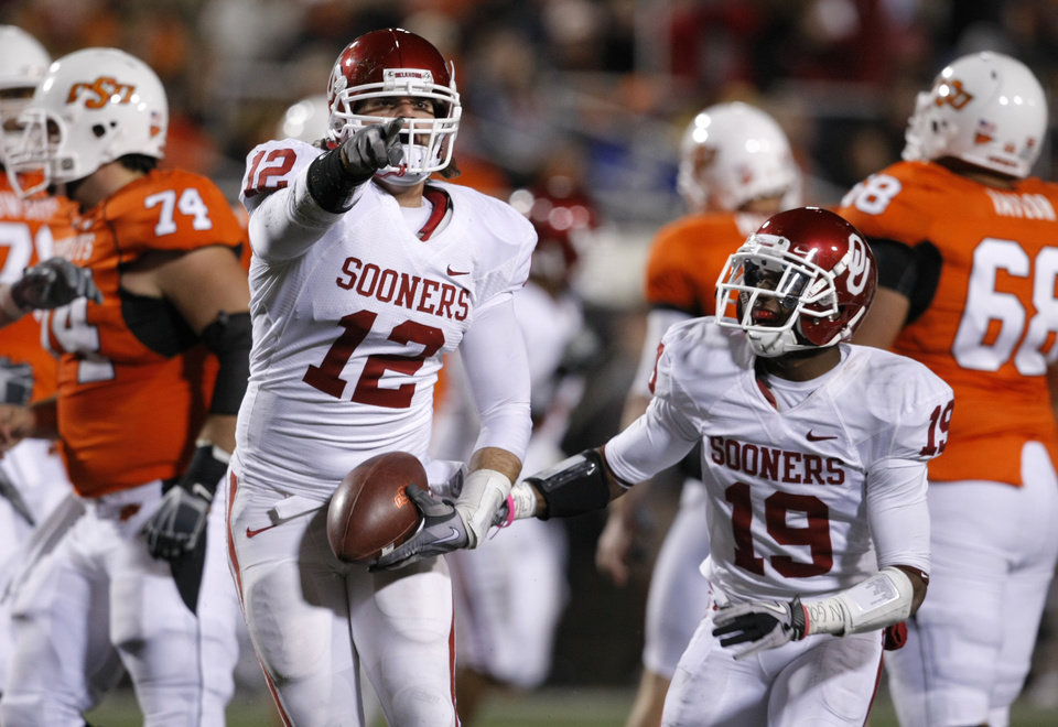Photo - Oklahoma's Austin Box (12) and Oklahoma's Demontre Hurst (19) react after an interception during the Bedlam college football game between the University of Oklahoma Sooners (OU) and the Oklahoma State University Cowboys (OSU) at Boone Pickens Stadium in Stillwater, Okla., Saturday, Nov. 27, 2010. Photo by Bryan Terry, The Oklahoman