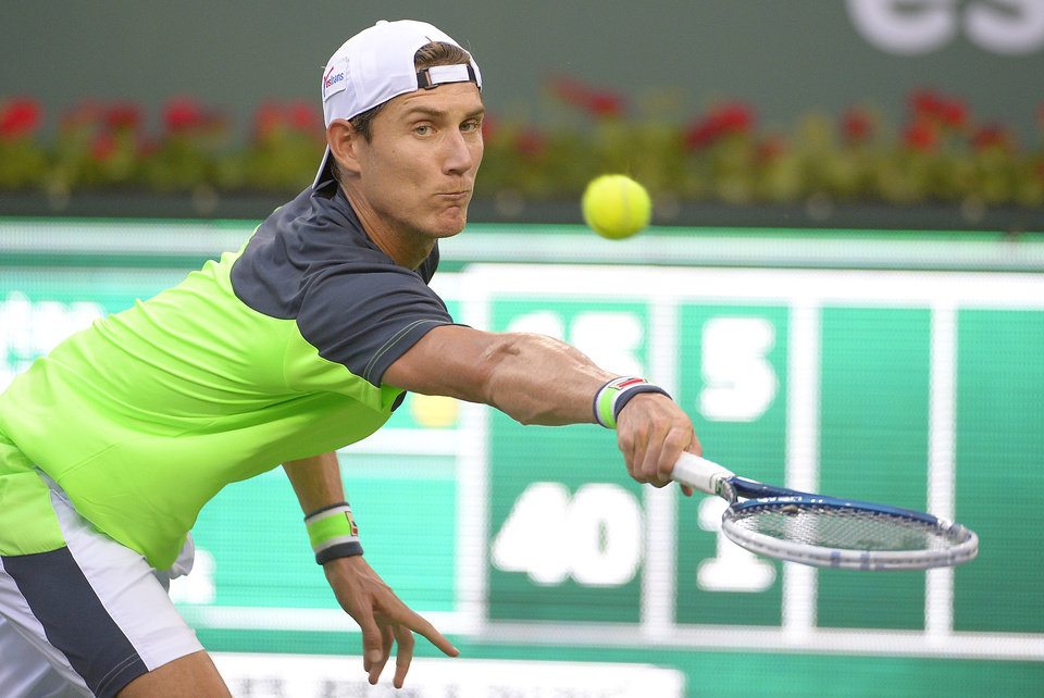 Photo - Matthew Ebden, of Australia, returns a shot against Lleyton Hewitt, of Australia, during a first round match at the BNP Paribas Open tennis tournament, Thursday, March 6, 2014, in Indian Wells, Calif. (AP Photo/Mark J. Terrill)