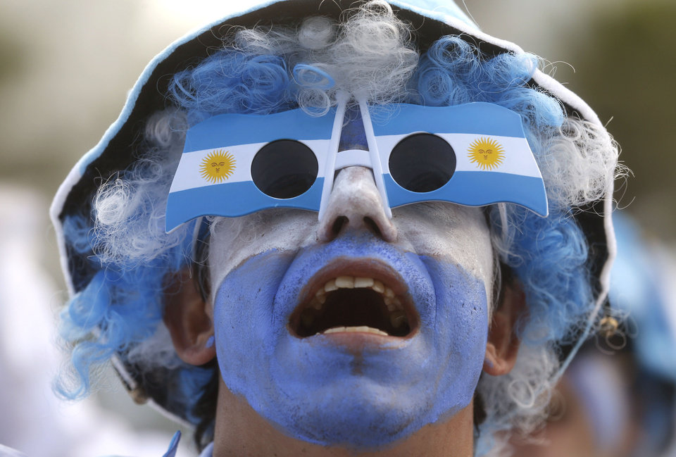 Photo - An Argentina soccer fan watches his team's World Cup match with Iran at a live telecast inside the FIFA Fan Fest area on Copacabana beach, in Rio de Janeiro, Brazil, Saturday, June 21, 2014. Argentina won 1-0. (AP Photo/Silvia Izquierdo)
