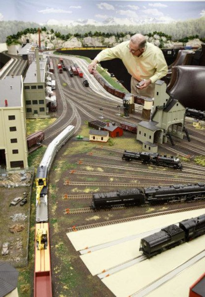 Photo - Jimmy Samis demonstrates his train collection at his home in Nichols Hills on Oct. 28. Photo by Paul Hellstern, The Oklahoman  PAUL HELLSTERN