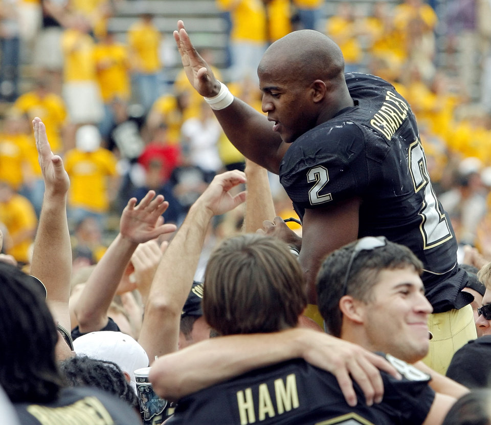 Photo - Colorado's Hugh Charles (2) celebrates with fans after the college football game between the University of Oklahoma Sooners (OU) and the University of Colorado Buffaloes (CU) at Folsom Field in Boulder, Co., on Saturday, Sept. 28, 2007. Colorado won, 27-24. By NATE BILLINGS, The Oklahoman