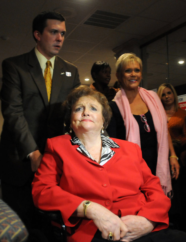 Photo -   Lucy Baxley is pushed in her wheelchair by son Louis Baxley as she arrives at the Alabama Democrats watch party to watch the election returns for her race for Public Service Commission president at Jubilee Seafood in Montgomery, Ala., on election night Tuesday, Nov. 6, 2012. (AP Photo/David Bundy)
