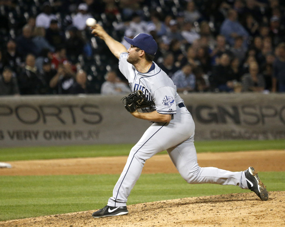 Photo - San Diego Padres relief pitcher Huston Street delivers during the ninth inning of an interleague baseball game against the Chicago White Sox on Friday, May 30, 2014, in Chicago. San Diego won 4-1. (AP Photo/Charles Rex Arbogast)