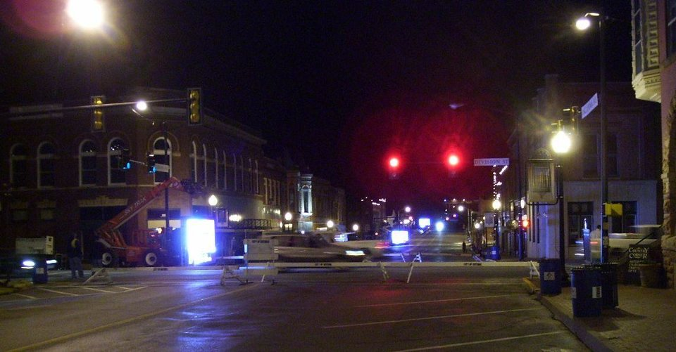 """Crews setting up """"Jumbotrons"""" in downtown Guthrie in preperation for the centennial parade<br/><b>Community Photo By:</b> Martin B.<br/><b>Submitted By:</b> Jimmy, Guthrie"""