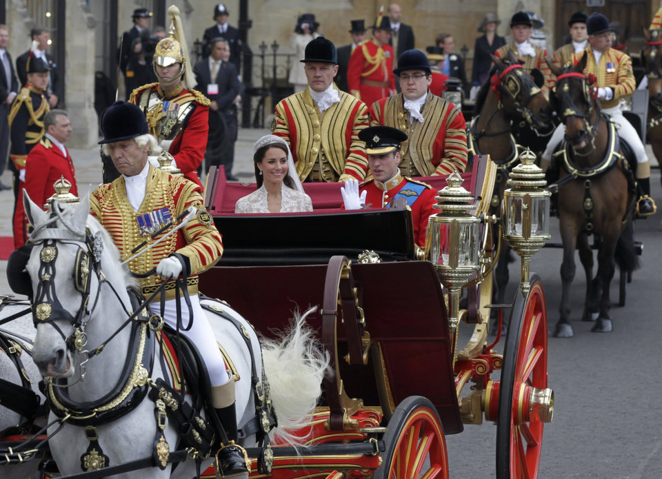 Photo - Britain's Prince William, right, and his wife Kate, Duchess of Cambridge, leave Westminster Abbey at the Royal Wedding in London Friday, April, 29, 2011. (AP Photo/Alastair Grant)  ORG XMIT: RWFO142