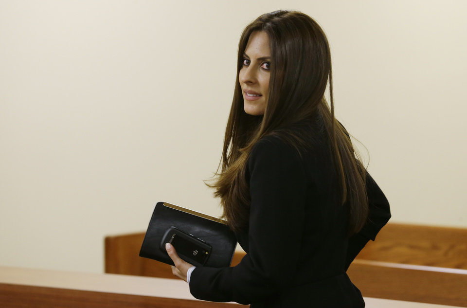 Photo - FILE -In this May 30, 2014 file photo, Kerri Kasem, the daughter of ailing radio personality Casey Kasem, leaves Kitsap County Superior Court, in Port Orchard, Wash. A judge in Washington state has granted Kasem's daughter a temporary restraining order preventing the famous radio host's wife, Jean Kasem, from cremating or removing his remains from a funeral home. Kasem, the radio host of