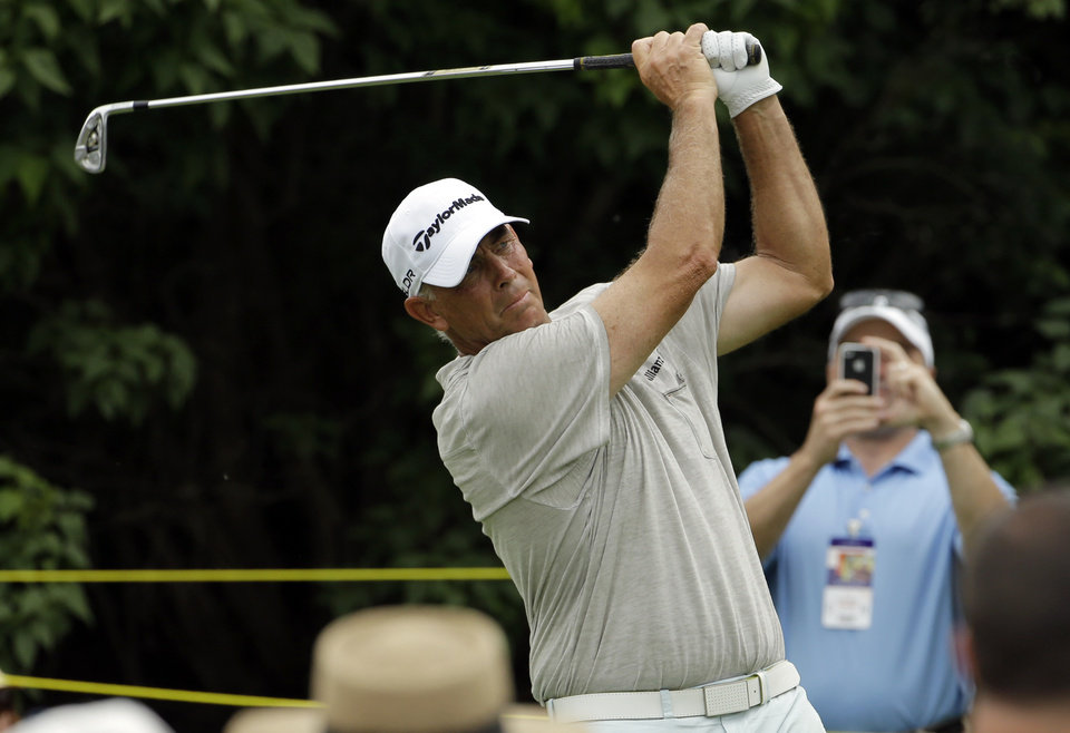Photo - Tom Lehman hits a tee shot on the 17th hole during the second round of the Encompass Championship golf tournament in Glenview, Ill., Saturday, June 21, 2014. (AP Photo/Nam Y. Huh)