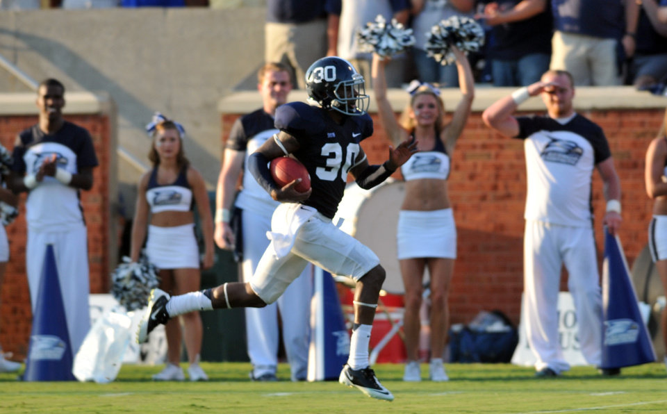 Photo -   Georgia Southern cornerback Valdon Cooper races to the end zone for a touchdown after an interception against Jacksonville during the first half of an NCAA college football game, Saturday, Sept. 1, 2012, in Statesboro, Ga. (AP Photo/The Morning News, Richard Burkhart) THE EXAMINER.COM OUT; SFEXAMINER.COM OUT; WASHINGTONEXAMINER.COM OUT