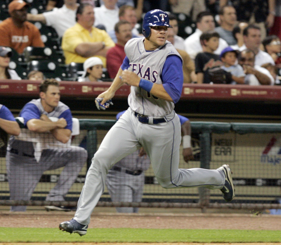 Photo - Texas Rangers' Chris Davis runs down the third base line to score from first base on a Marlon Byrd triple in the ninth inning against the Houston Astros in a major league baseball game Thursday, June 26, 2008 in Houston. Houston won 7-2. Davis was called up from Triple-A Oklahoma on Thursday. (AP Photo/Pat Sullivan) ORG XMIT: HTA112