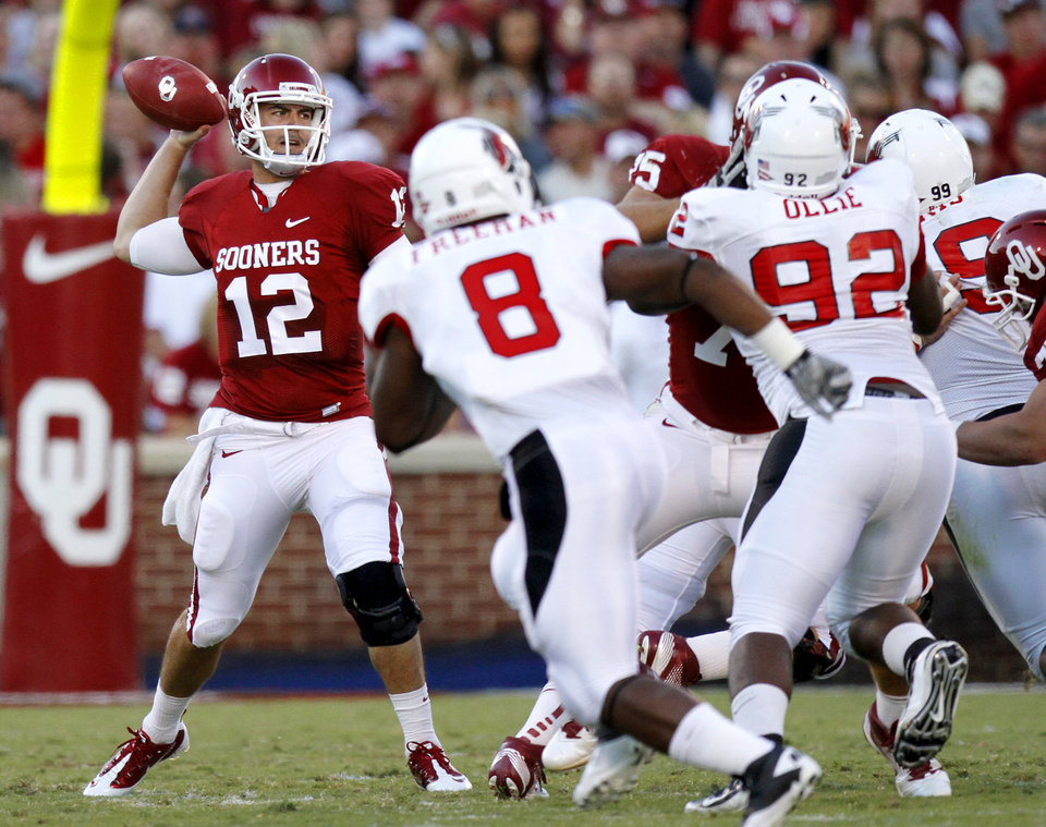Photo - Oklahoma's Landry Jones (12) throws a pass during the college football game between the University of Oklahoma Sooners (OU) and the Ball State Cardinals at Gaylord Family-Memorial Stadium on Saturday, Oct. 01, 2011, in Norman, Okla. Oklahoma won 62-6. Photo by Bryan Terry, The Oklahoman