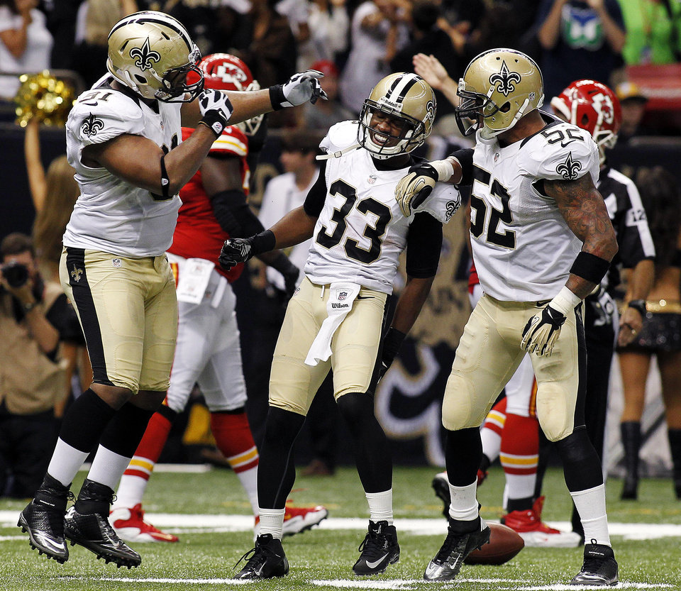 Photo -   New Orleans Saints cornerback Jabari Greer (33) celebrates his interception with defensive end Will Smith (91) and linebacker Jonathan Casillas (52) in the second half of an NFL football game in New Orleans, Sunday, Sept. 23, 2012. (AP Photo/Jonathan Bachman)
