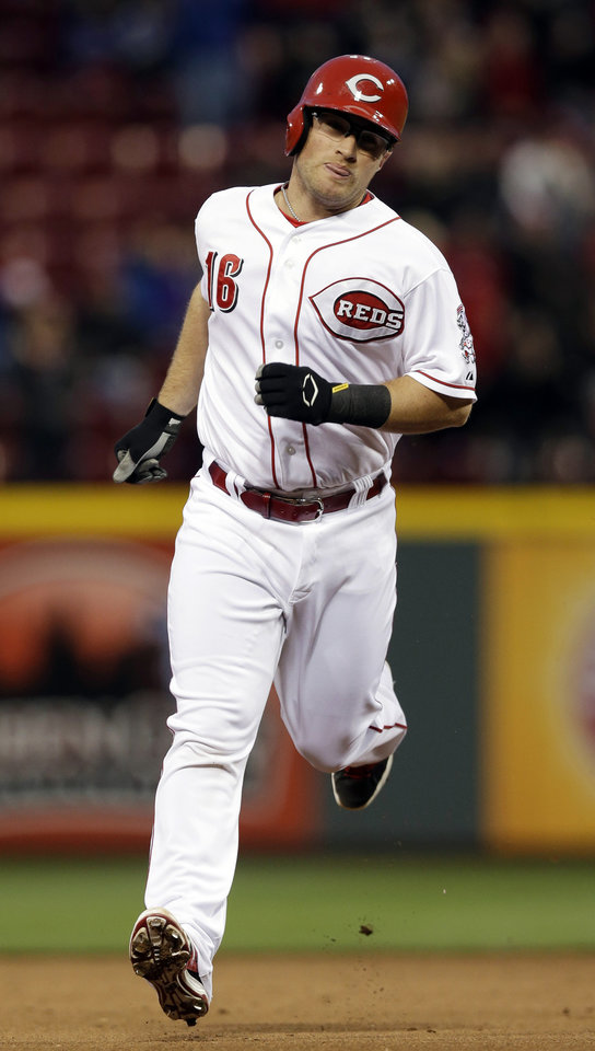 Photo - Cincinnati Reds' Tucker Barnhart rounds the bases after hitting a solo home run off Milwaukee Brewers starting pitcher Marco Estrada in the fifth inning of a baseball game, Thursday, May 1, 2014, in Cincinnati. (AP Photo/Al Behrman)