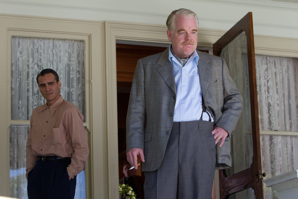 Photo -  Joaquin Phoenix, left, and Philip Seymour Hoffman co-star in
