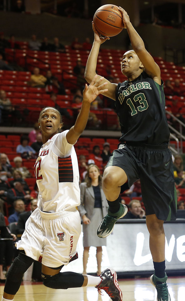 Photo - Baylor's Nina Davis, right, shoots over Texas Tech's Amber Battle during an NCAA college basketball game in Lubbock, Texas, Wednesday, Feb. 12, 2014. (AP Photo/The Avalanche-Journal, Tori Eichberger)