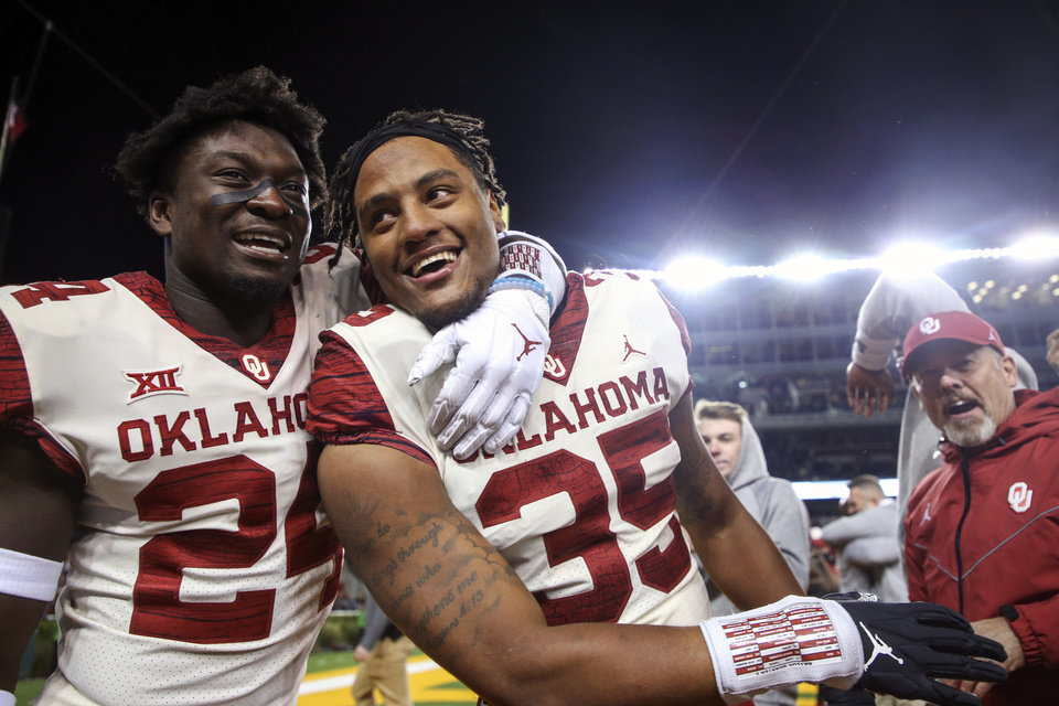 Photo - Oklahoma linebacker Brian Asamoah (24) celebrates with linebacker Nik Bonitto (35) after Bonitto got an interception that secured a 34-31 win over Baylor in an NCAA college football game, Saturday, Nov. 16, 2019, in Waco, Texas. (Ian Maule/Tulsa World via AP)
