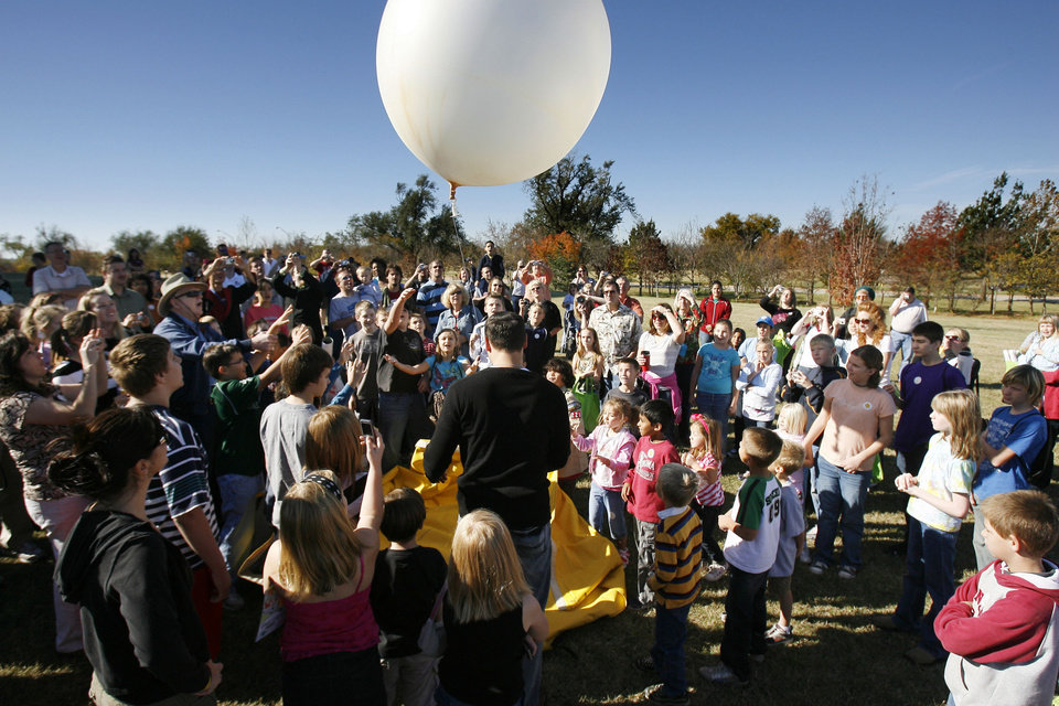 Weather enthusiasts of all ages gather to watch a weather balloon released at the 2009 National Weather Festival in Norman. This year\'s festival is scheduled 9 a.m. to 1 p.m. Saturday. PHOTO BY PAUL HELLSTERN, THE OKLAHOMAN