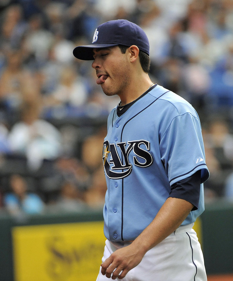 Photo -   Tampa Bay Rays starting pitcher Matt Moore walks back to the dugout after being taken out of the baseball game by manager Joe Maddon during the fifth inning against the Oakland Athletics on Sunday, May 6, 2012, in St. Petersburg, Fla. (AP Photo/Brian Blanco)