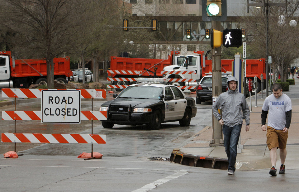 Photo - Police roadblock for security surrounding the President's visit at Main and E.K. Gaylord on the drive home Wednesday, March 21, 2012. Photo by Doug Hoke, The Oklahoman