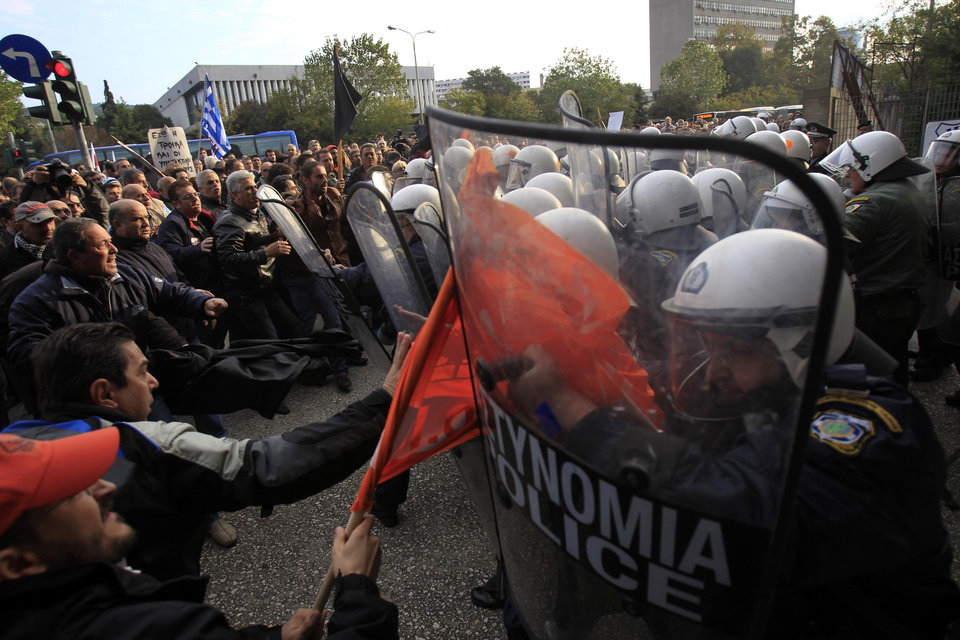 Photo -   Protesters clash with police before a conference of Greek and German mayors in the northern Greek port city of Thessaloniki, Thursday, Nov. 15, 2012. Dozens of anti-austerity protesters broke into a conference and clashed with police to demonstrate against the presence of a German government official. (AP Photo/Nikolas Giakoumidis)