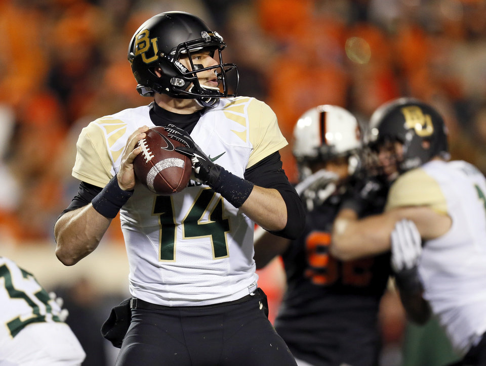 Baylor\'s Bryce Petty (14) looks to pass during a college football game between the Oklahoma State University Cowboys (OSU) and the Baylor University Bears (BU) at Boone Pickens Stadium in Stillwater, Okla., Saturday, Nov. 23, 2013. Photo by Nate Billings, The Oklahoman