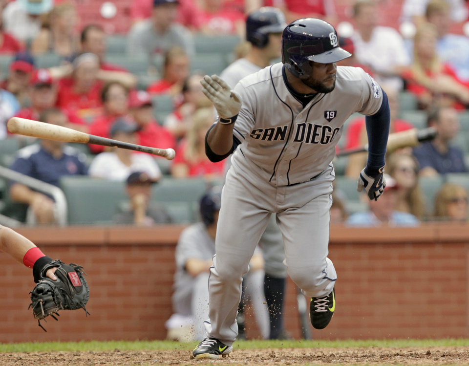 Photo - San Diego Padres' Abraham Almonte tosses his bat after hitting a two-RBI single in the ninth inning of a baseball game against the St. Louis Cardinals, Sunday, Aug. 17, 2014, in St. Louis. The Cardinals won 7-6. (AP Photo/Tom Gannam)