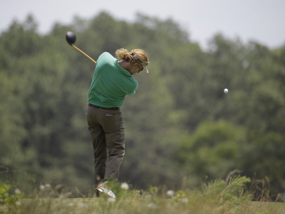 Photo - Miguel Angel Jimenez, of Spain, hits his tee shot on the forth hole during a practice round for the U.S. Open golf tournament in Pinehurst, N.C., Wednesday, June 11, 2014. The tournament starts Thursday. (AP Photo/Eric Gay)
