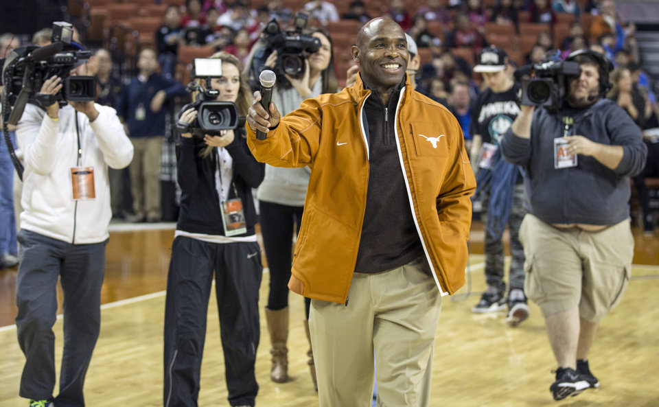 Photo - FILE - In this Wednesday, Jan. 8, 2014 file photo, Texas new head football coach Charlie Strong speaks to fans during a timeout against Oklahoma in the first half of an NCAA college basketball game in Austin, Texas. There are 125 colleges playing in the top-level Football Bowl Subdivision. In 2013, 13 of them had black coaches. That was down from 15 in 2012 and an all-time high of 17 in 2011. Strong and James Franklin at Penn State have not been replaced by African-Americans, so the overall numbers remain low. (AP Photo/Austin American- Statesman, Ricardo B. Brazziell) MANDATORY CREDIT: AUSTIN AMERICAN- STATESMAN, RICARDO B. BRAZZIELL