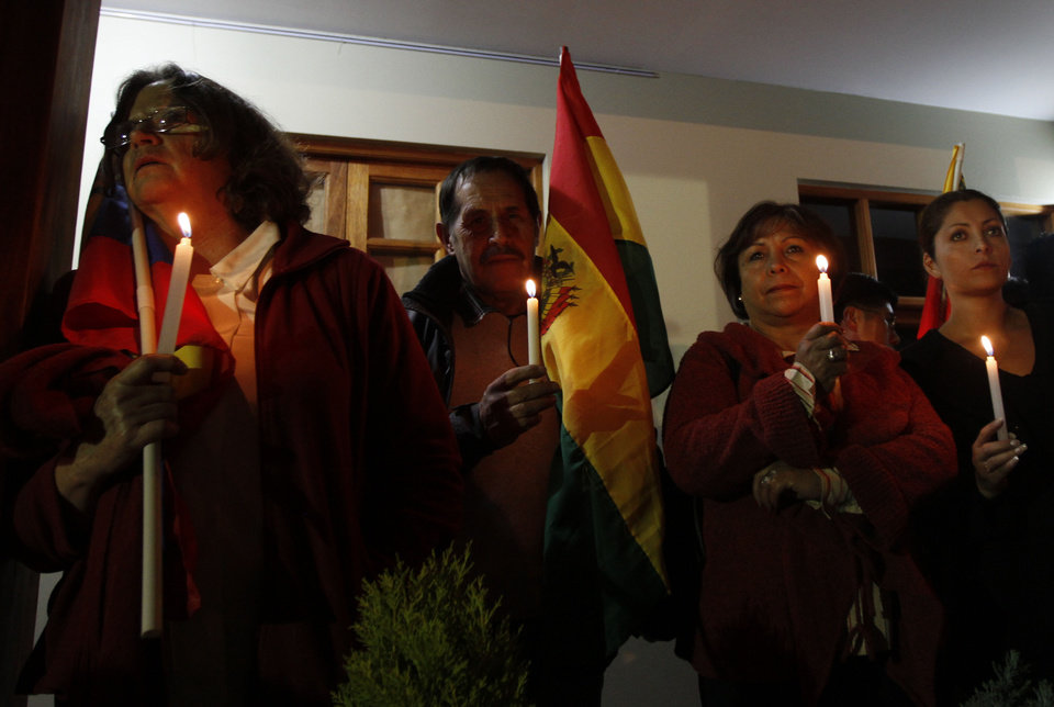 Photo - People participate in a vigil for Venezuela's President Hugo Chavez in La Paz, Bolivia, Monday Dec. 10, 2012. Chavez's cancer relapse and his sudden announcement that he will undergo a fourth cancer-related surgery in Cuba have thrown Venezuela's future into question. (AP Photo/Juan Karita)