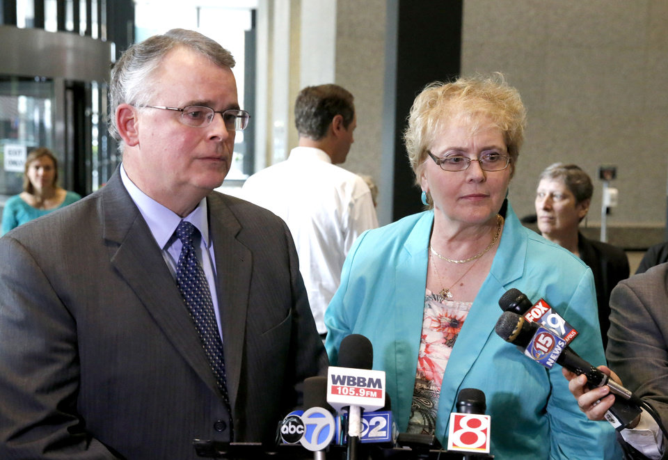 Photo - Julaine Appling, president of Wisconsin Family Action, right, and her organization's attorney Mike Dean, defenders of Wisconsin's state ban on gay marriage, talk to reporters after attending a hearing before the 7th U.S. Circuit Court of Appeals on the challenges to Indiana and Wisconsin's gay marriage ban Tuesday, Aug. 26, 2014, in Chicago. (AP Photo/Charles Rex Arbogast)