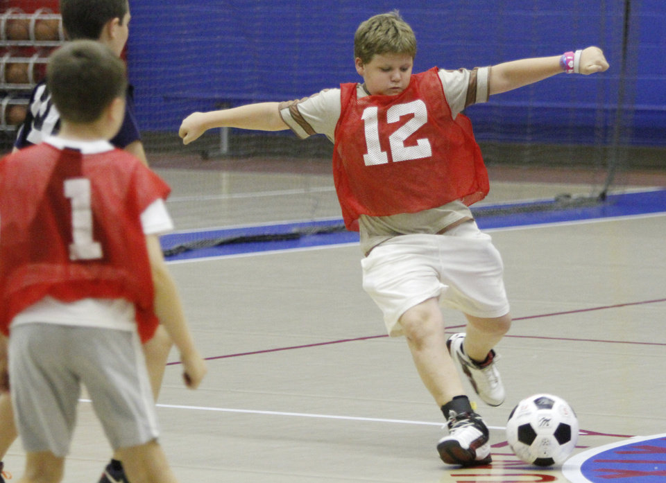 Alex Haworth, 11, shoots the ball during a soccer camp scrimmage at Oklahoma City Community College in Oklahoma City, Monday 16, 2012. Photo By Steve Gooch, The Oklahoman