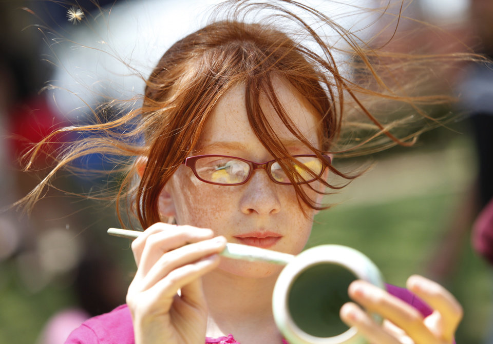 Elizabeth Trayah, 9, paints a clay pot as the wind blows her hair at the 2011 Festival of the Arts in Oklahoma City. Photo by Steve Gooch, The Oklahoman Archives. <strong>Steve Gooch - The Oklahoman</strong>