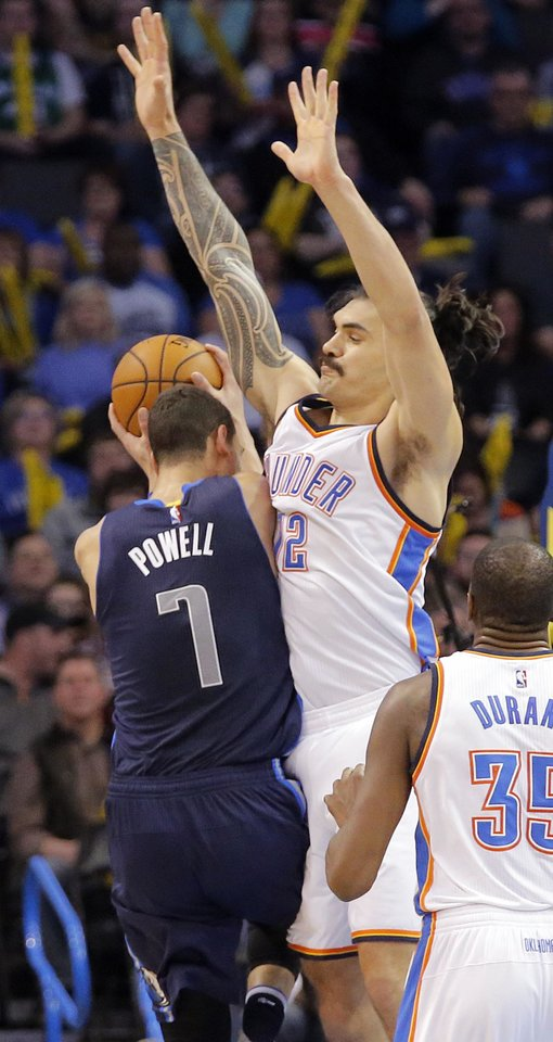 Photo - Oklahoma City's Steven Adams (12) defends on Dallas' Dwight Powell (7) during the NBA basketball game between the Oklahoma City Thunder and the Dallas Mavericks at Chesapeake Energy Arena on Wednesday, Jan. 13, 2016, in Oklahoma City, Okla.  Photo by Chris Landsberger, The Oklahoman