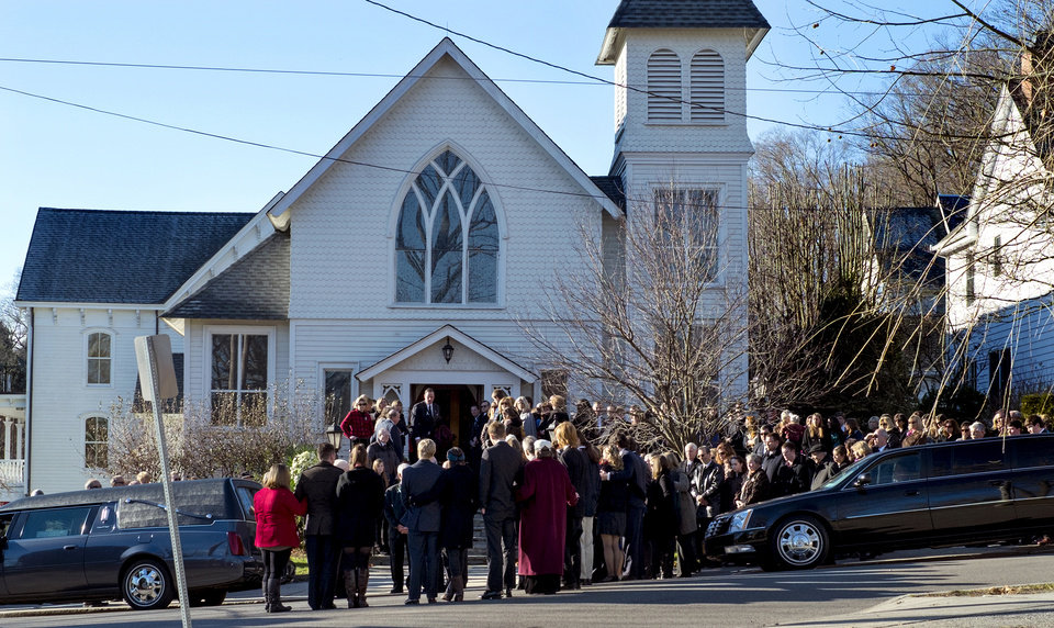 Photo - Mourners gather at the funeral for teacher Anne Marie Murphy at the St. Mary Of The Assumption Church in Katonah, N.Y. Thursday, Dec. 20, 2012. Murphy was killed when Adam Lanza, walked into Sandy Hook Elementary School in Newtown, Conn., Dec. 14, and opened fire, killing 26, including 20 children, before killing himself.  (AP Photo/Craig Ruttle)